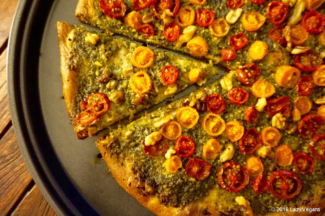 Pizza with basil pesto and tomatoes