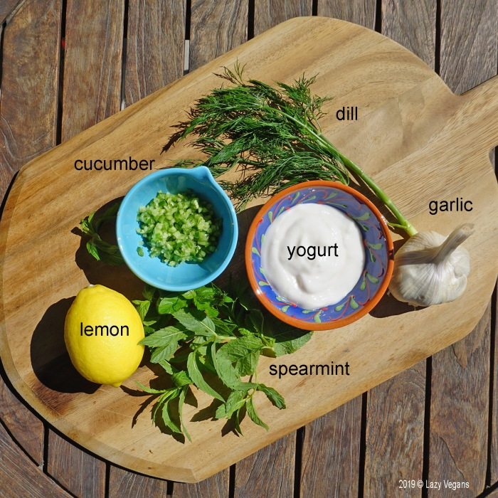 tzatziki ingredients: yogurt, cucumber, garlic, lemon, dill, spearmint