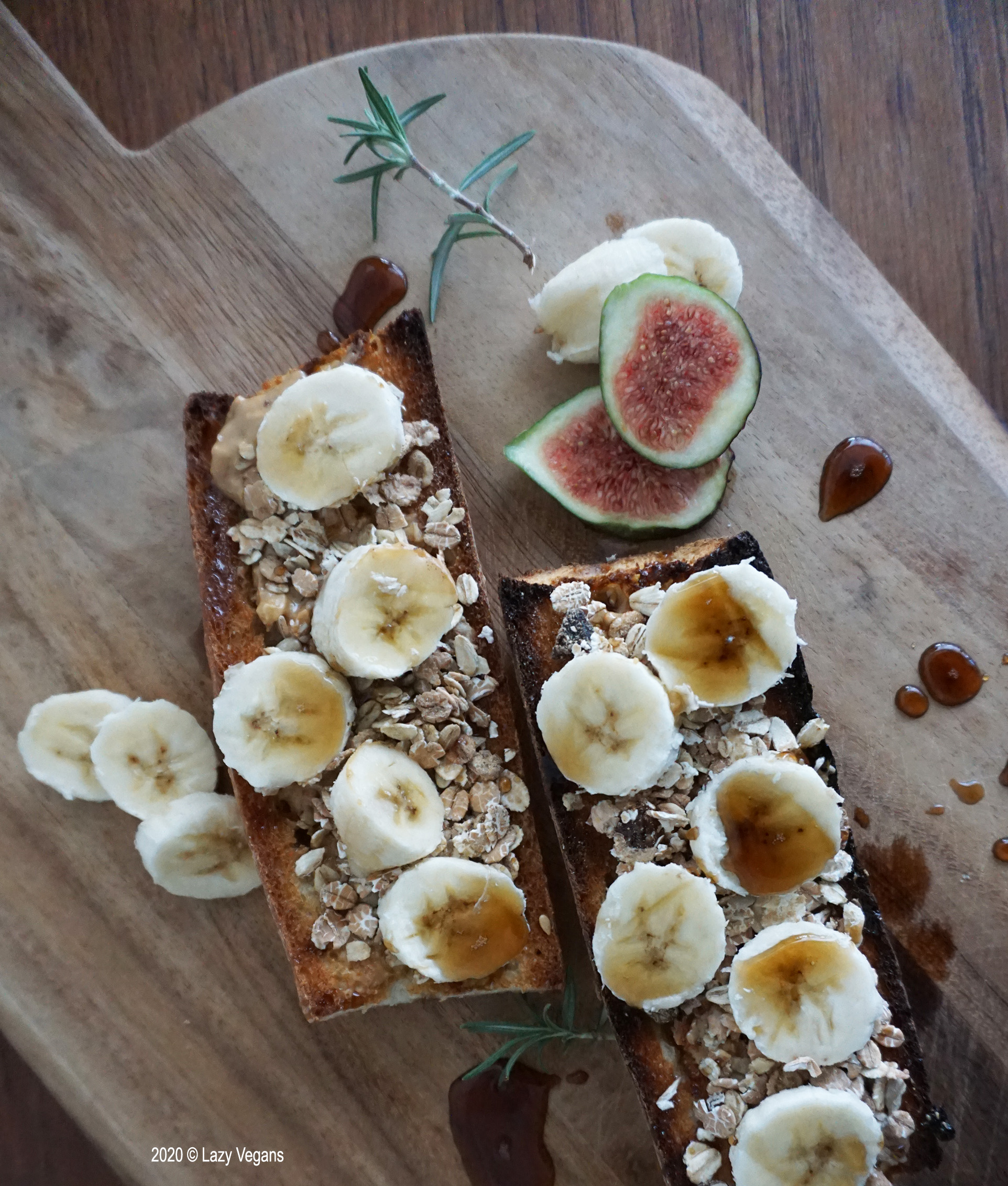 bananas, figs, rosemary, maple syrup and granola on a toasted baguette