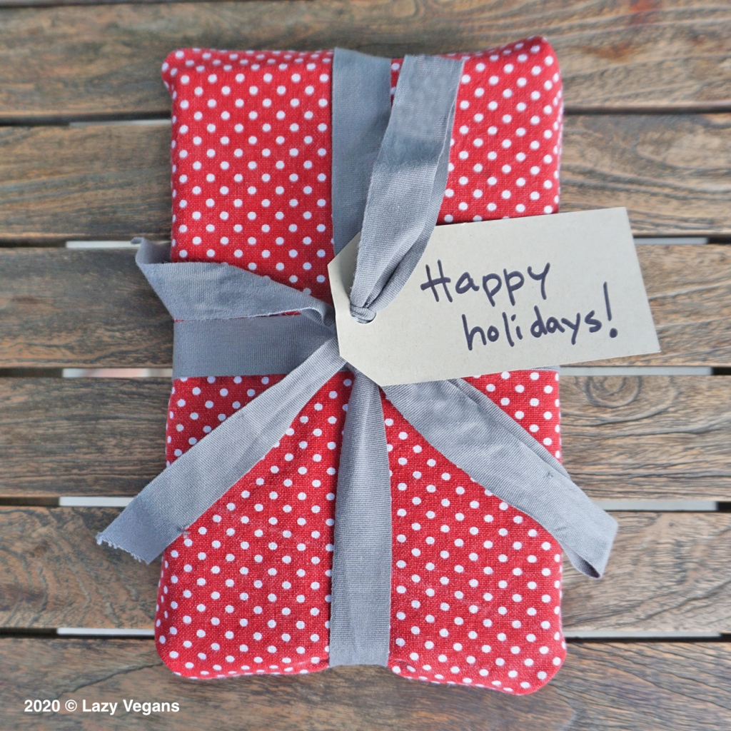 gift wrapped in a red tea towel and grey ribbon